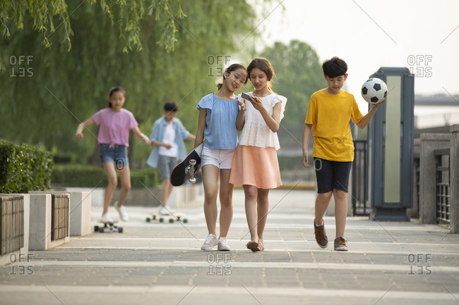Teenagers having fun outdoors together