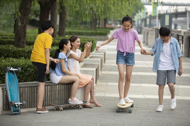 Teenagers skateboarding and having fun outdoors