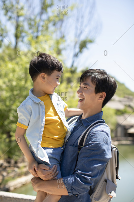 Happy Chinese father and son enjoying vacation