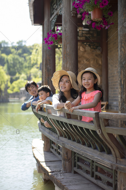 Young Chinese family enjoying vacation