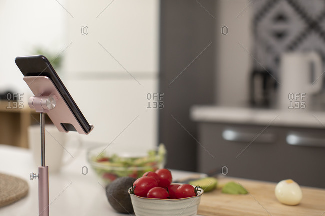 Smartphone and ingredients on kitchen counter