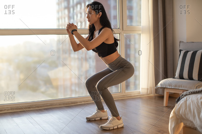 Young Chinese woman exercising at home