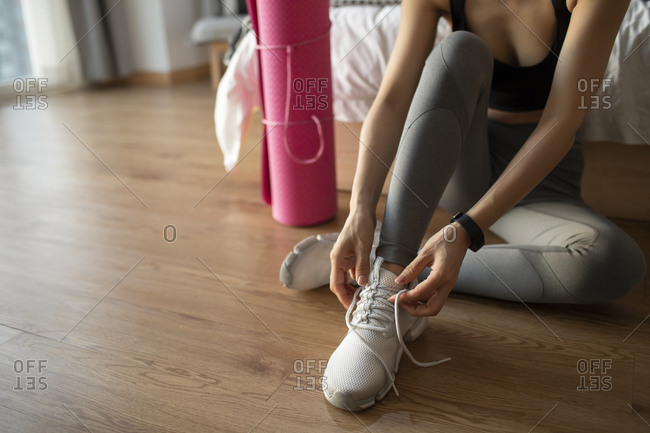 Young Chinese woman getting ready for morning exercise