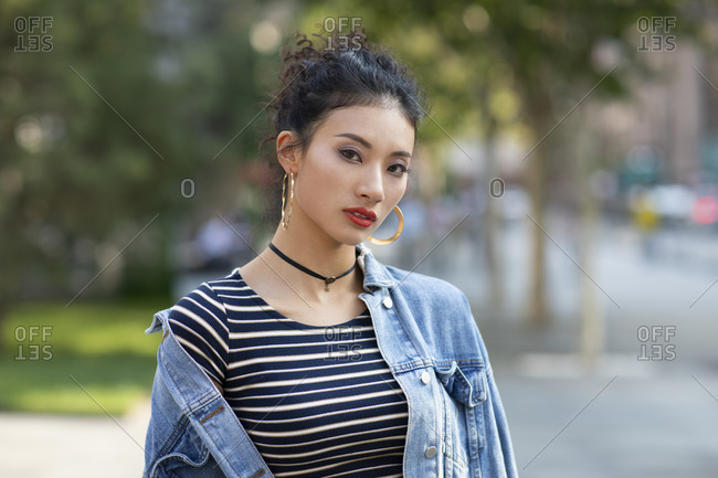 Fashionable young Chinese woman on street