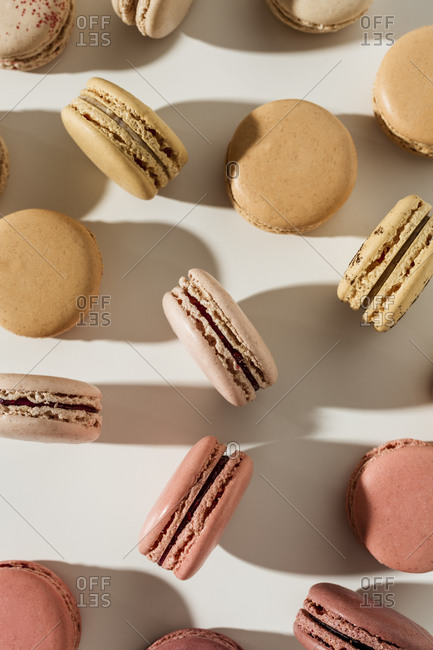 Overhead view of macarons on white surface
