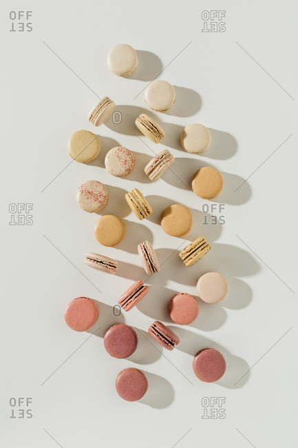 Top view of an assortment of macarons on white surface