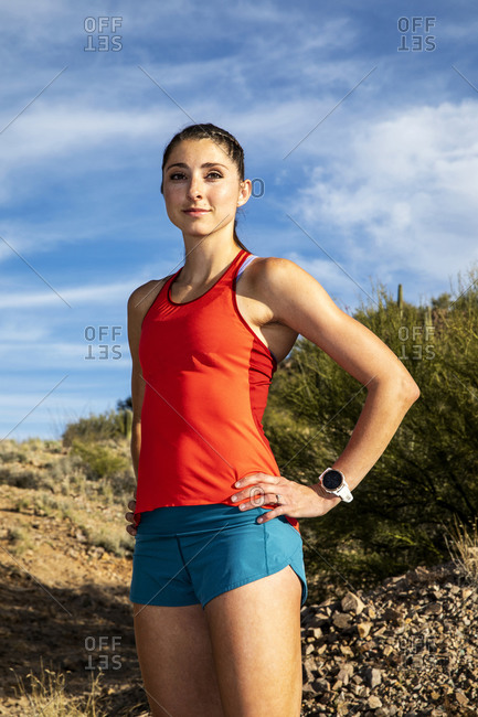 Portrait of a young woman dressed in athletic clothing outdoors