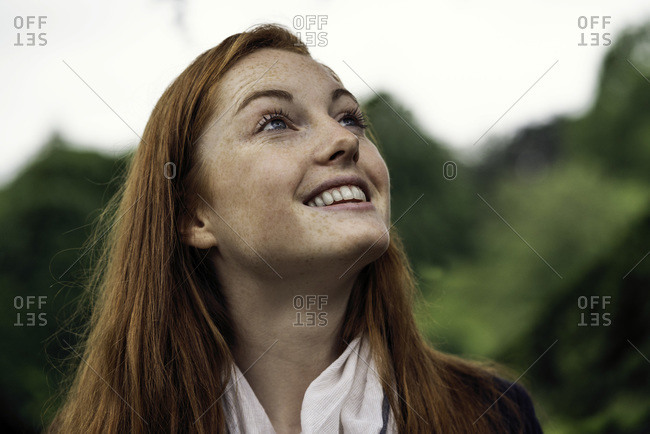 Young woman smiling and looking up