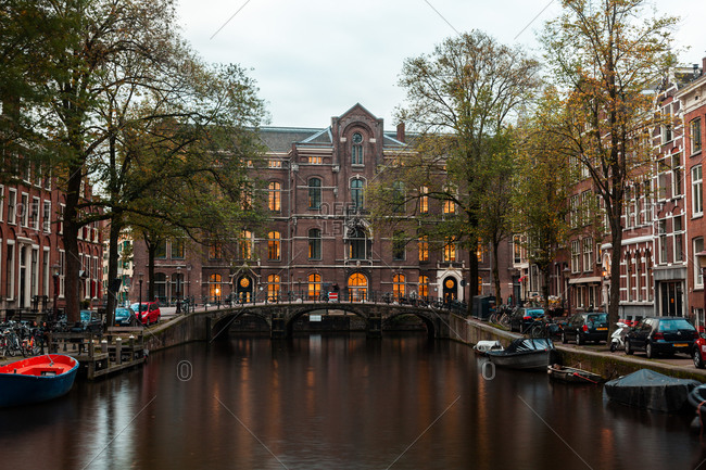 Amsterdam, Netherlands May 6, 2020: View of Dutch houses and bridge over canal