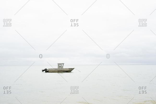 Lone boat moored at sea