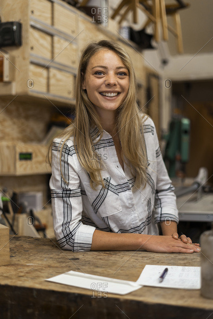 Smiling woman standing in workshop