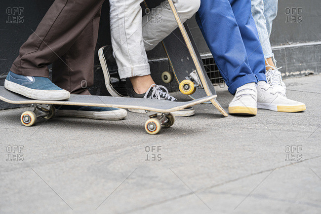 Friends with skateboards, view of feet
