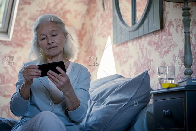 Senior woman watching video on smart phone