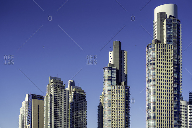 View of skyscrapers against blue sky