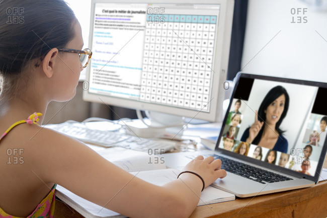 Girl attending online school classes from home