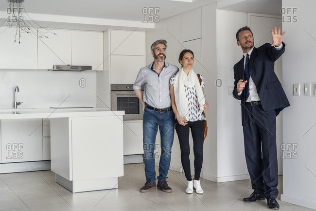 Real estate agent showing new house to couple