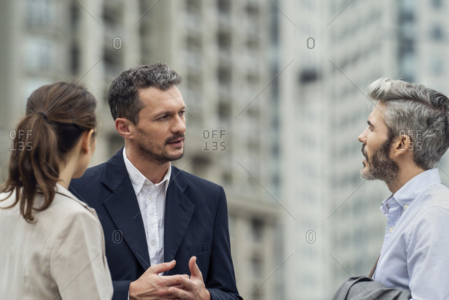 Businesspeople talking in a city