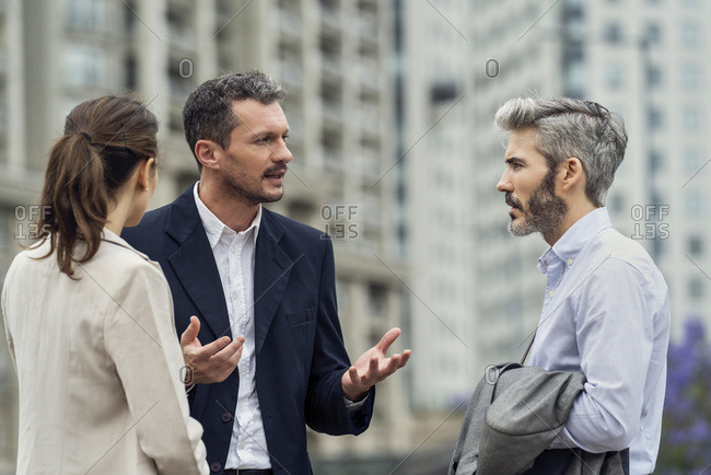 Businesspeople having a discussion outdoors