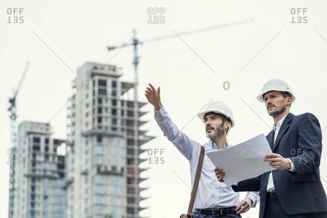 Male architects working at construction site