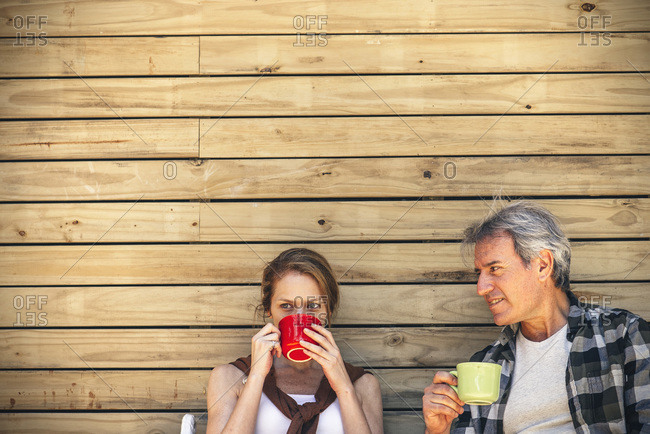 Couple having coffee outdoors together
