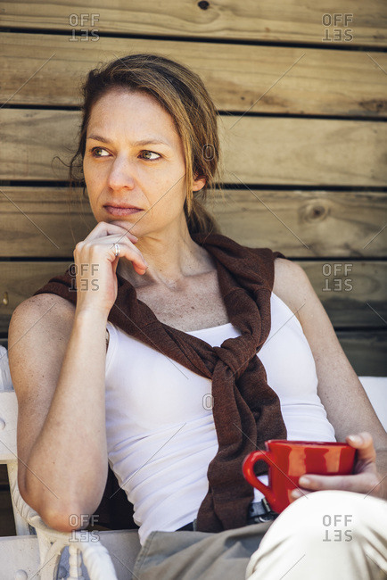 Mature woman sitting with coffee cup
