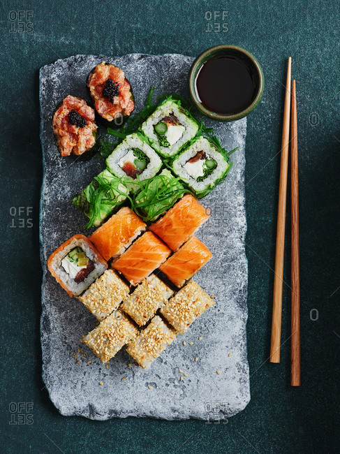 Assorted Japanese maki and qunkan sushi rolls set with chopsticks and soy sauce