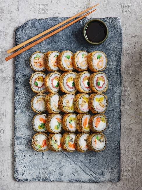 Assorted battered and deep-fried futo maki rolls with salmon, tuna, shrimps and vegetables