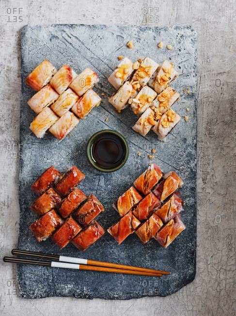Beautifully plated Japanese seafood maki sushi set with chopsticks and soy sauce