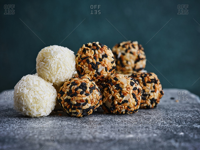 Assorted sweet and sticky rice balls on dark background