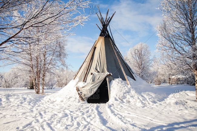 Teepee in the middle of a snowy forest