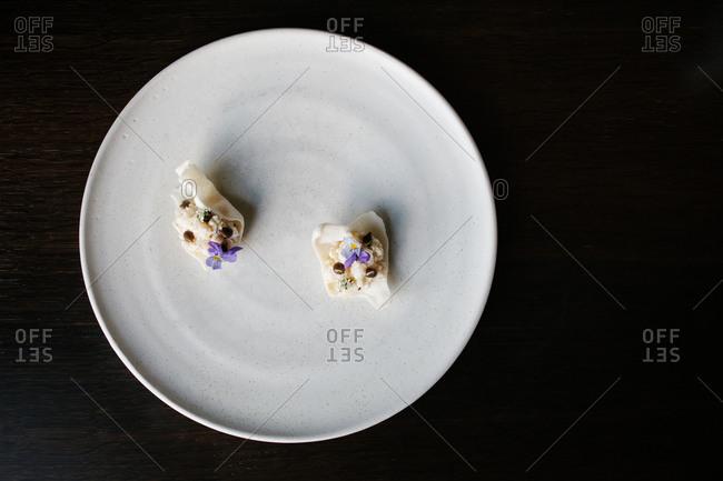 A gourmet dessert with edible flowers