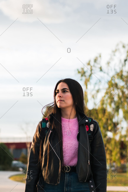 Portrait of a university student walking on the campus