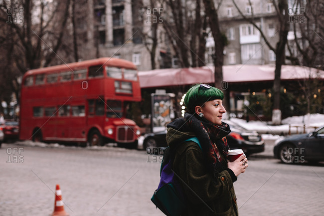 Portrait of non-binary female hipster standing on street in city