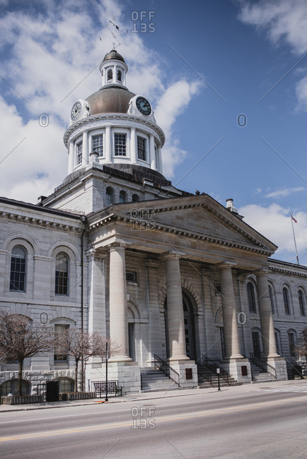 Kingston City hall building on an empty street on spring day.