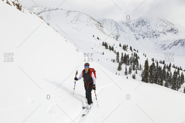 Woman on backcountry ski tour, Mayflower Gulch, Colorado