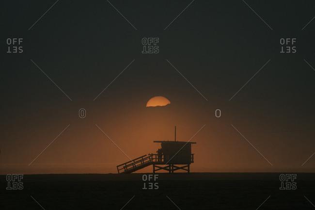 Moody Sunset of Lifeguard Tower In Venice Beach, California