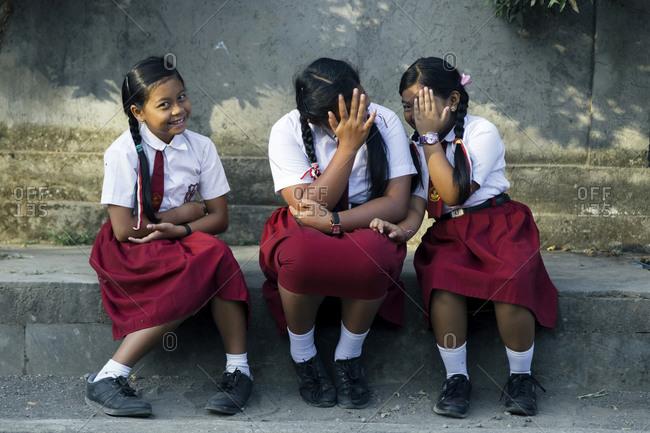 Bali, Indonesia - November 11, 2019: Portrait of schoolgirls in uniform
