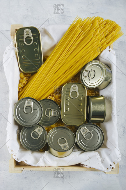 Top view of various cans of non-perishable food and spaghetti