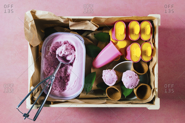 Delicious ice cream and refreshing popsicles in a rustic wooden box