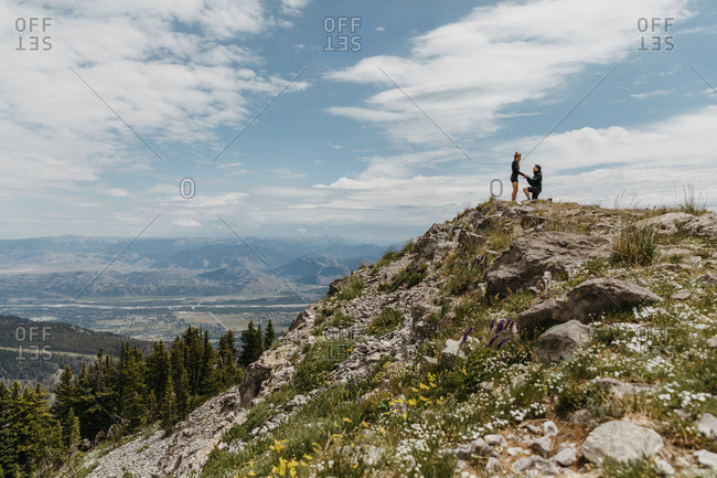Boyfriend gets down on one knee and proposes on mountain in Wyoming