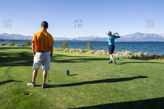 Two men playing golf at Edgewood Tahoe in Stateline, Nevada.
