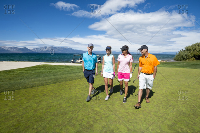 Four people playing golf at Edgewood Tahoe in Stateline, Nevada.