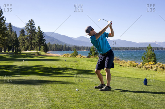 A man teeing off at Edgewood Tahoe in Stateline, Nevada.