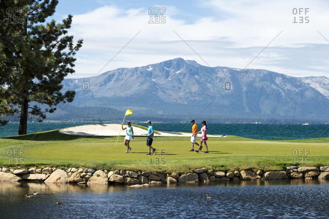 A group of friends golfing at Edgewood Tahoe in Stateline, Nevada.