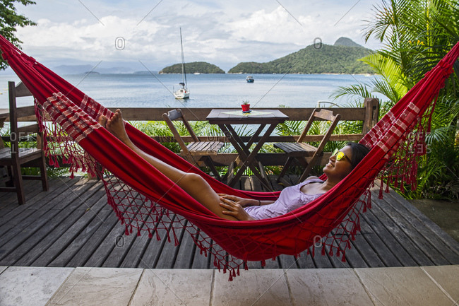 Woman relaxing in hammock on the tropical island of Ilha Grande