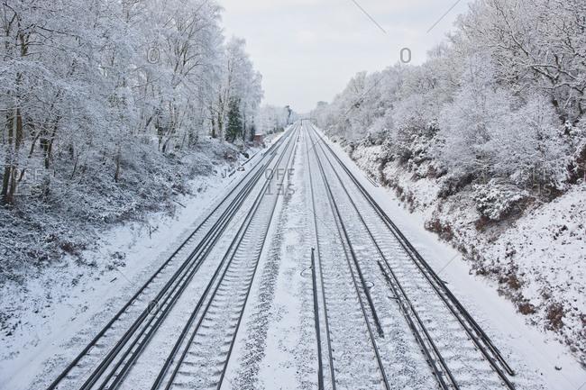 Train tracks in frozen winter landscape in south England