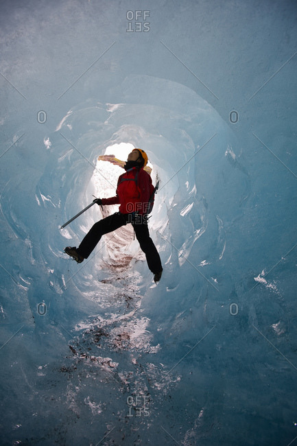 Woman exploring ice cave on Solheimajokull glacier in south Iceland
