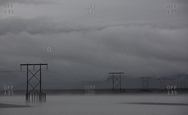 Pylons supporting power lines over the Solheimajokull area