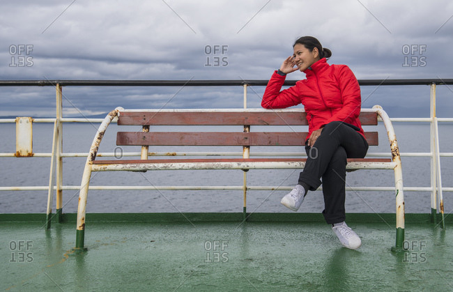 Woman relaxing on a passenger vessel traveling in South America