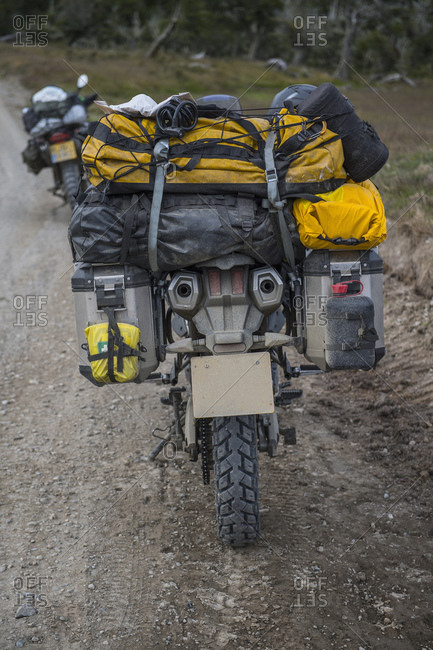 Heavily packed touring motorbike on dirt road, Tierra del Fuego